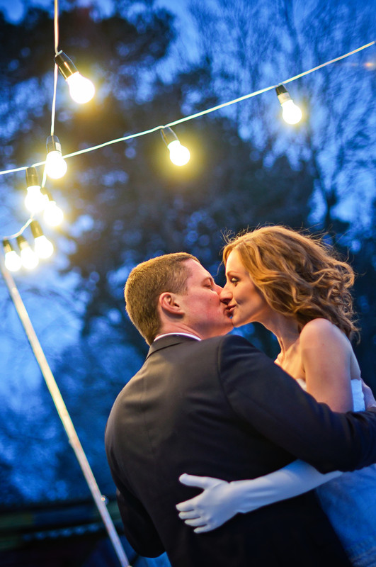 Ballroom Wedding Couple Kiss Under the Lights