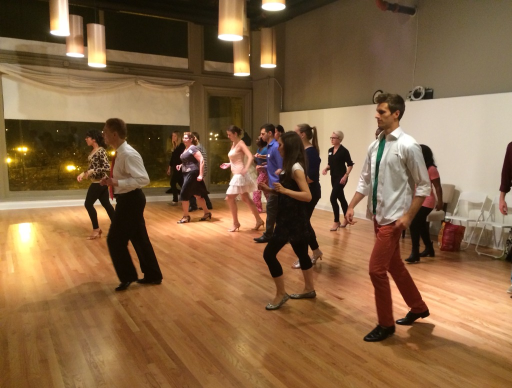Image of people dancing in a group class