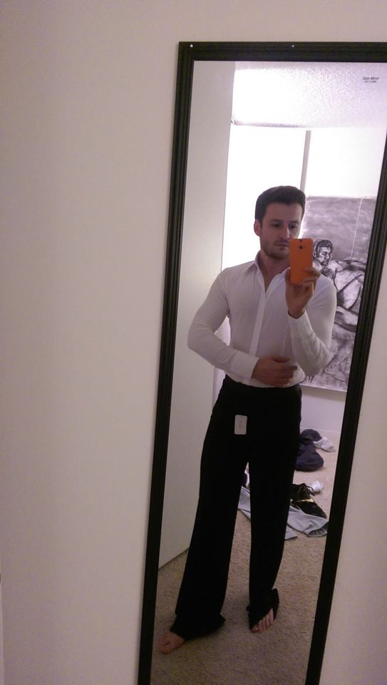 Adam trying on his costume for the ballroom dance event